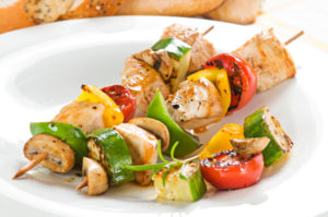 Grilled chicken with vegetables on stick close up