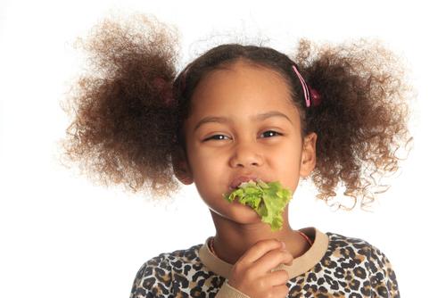 preschooler eating lettuce