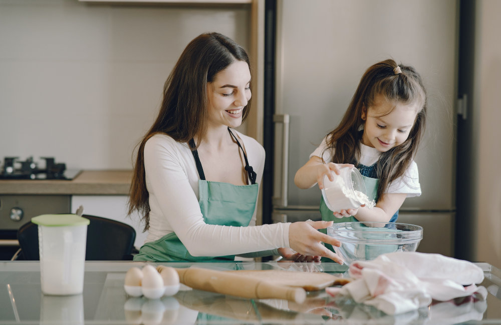 mother and pre-schooler baking