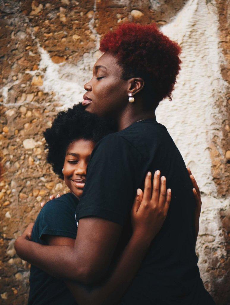 girl hugs