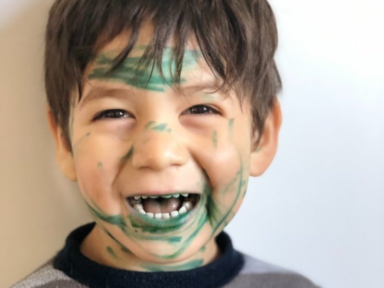 ADHD impulsive boy with ink all over his face